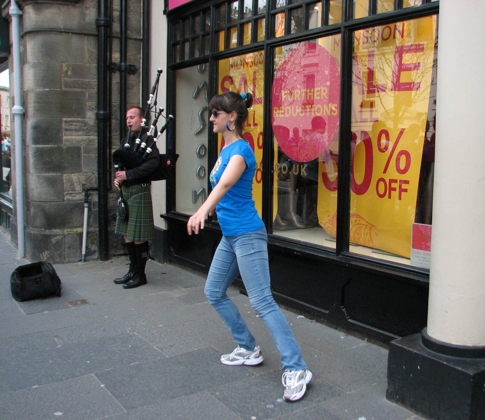 Anastasiia Gavryliuk performing a highland dance on the street of St Andrews
